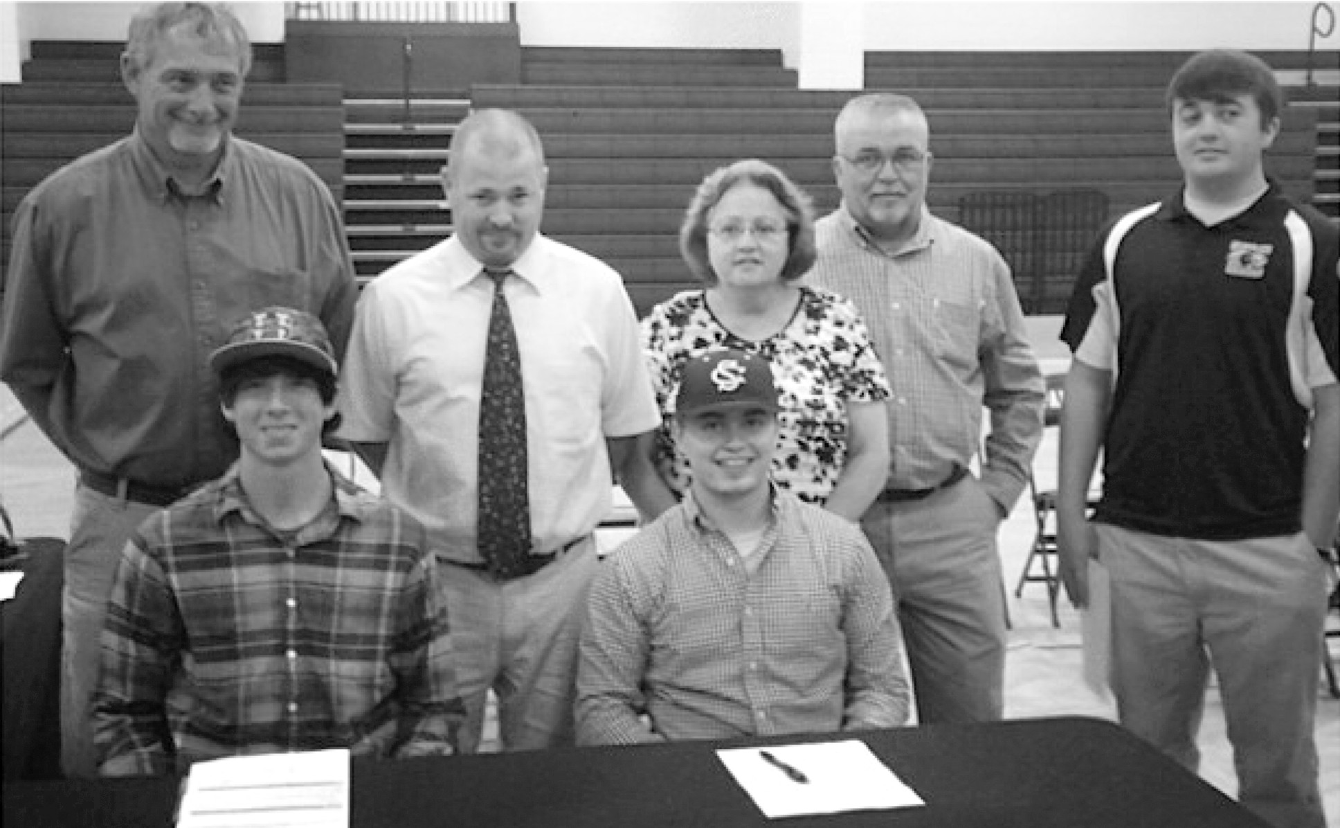 Cleveland's Chance Holliman and Jesse Aaron signed college baseball scholarships last month. Pictured are: (bottom row, left to right) Chance and Jesse; top row (l to r) Terry Holliman, Cleveland baseball coach Mike Johnson, Debbie Aaron, Barry Aaron, and Ben Aaron. Chance, who signed with with Southern Union Community College, was 7-2 with a 1.27 ERA. Jesse, who signed with Stillman College, hit .375 and was a two-year starter behind the plate.