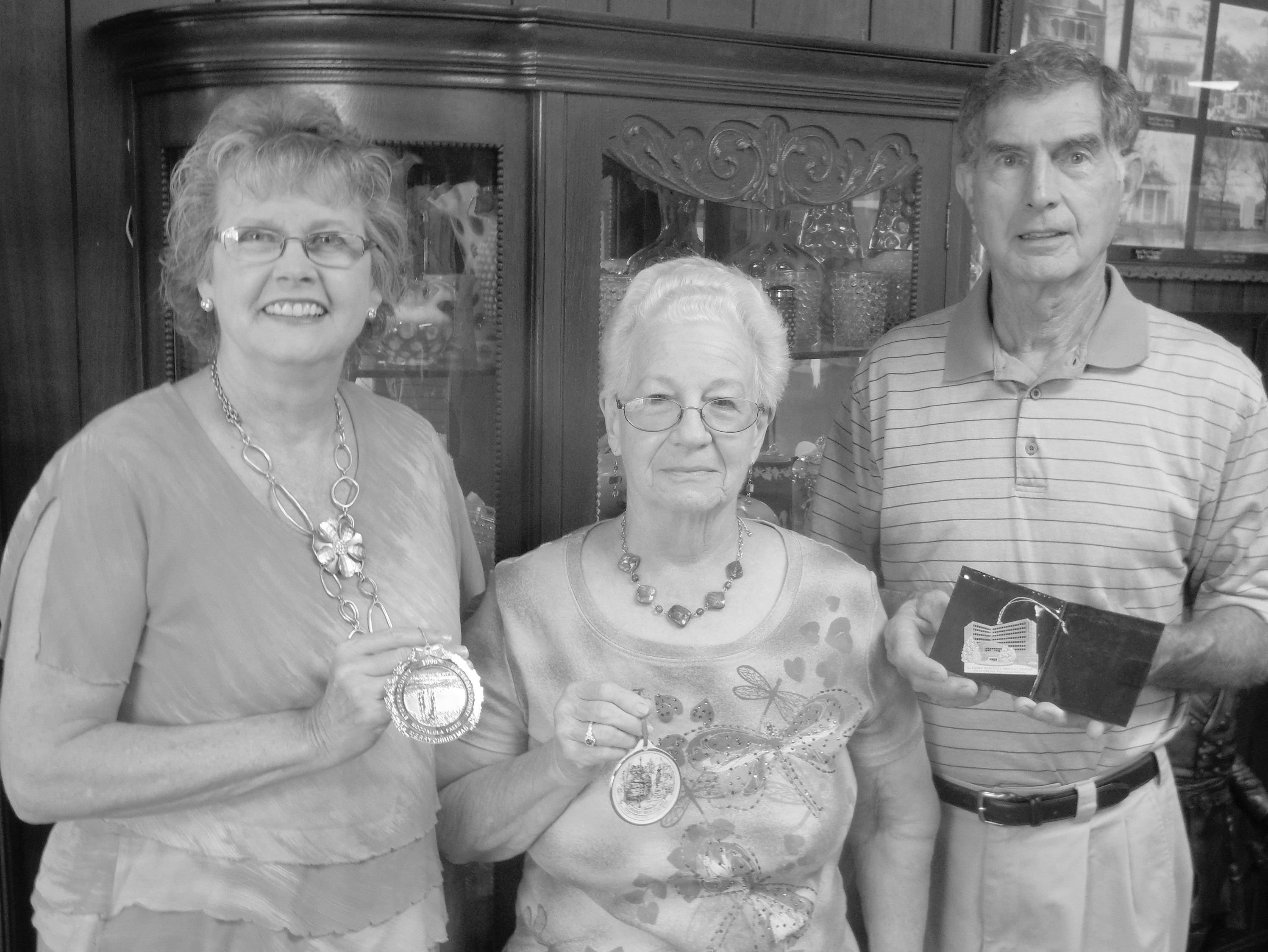 From left, Historical Society member Pam Dean, museum committee member Margaret Hudson, and Historical Society member Max Pate hold ornaments which will be similar to those sold during the Blount County Fair.