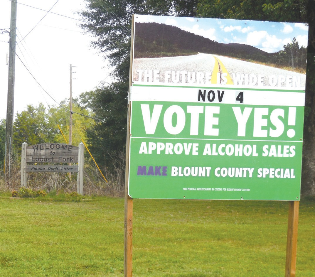 Activists in Oneonta allowed Locust Fork alcohol sale proponents to use their old Vote Wet signs to prepare for the town's upcoming referendum vote.