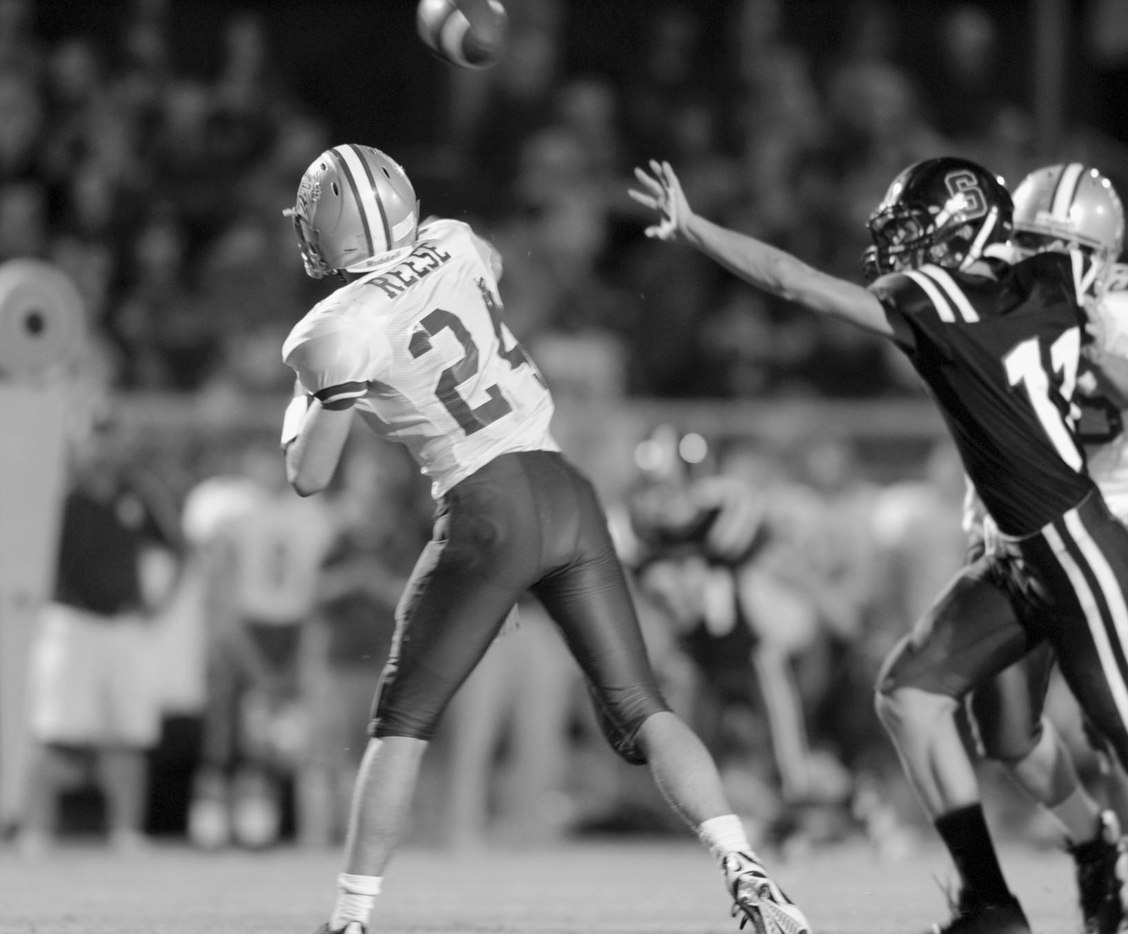 Appalachian quarterback Brandon Reese fires a pass as Southeastern's Austin Cates closes in.
