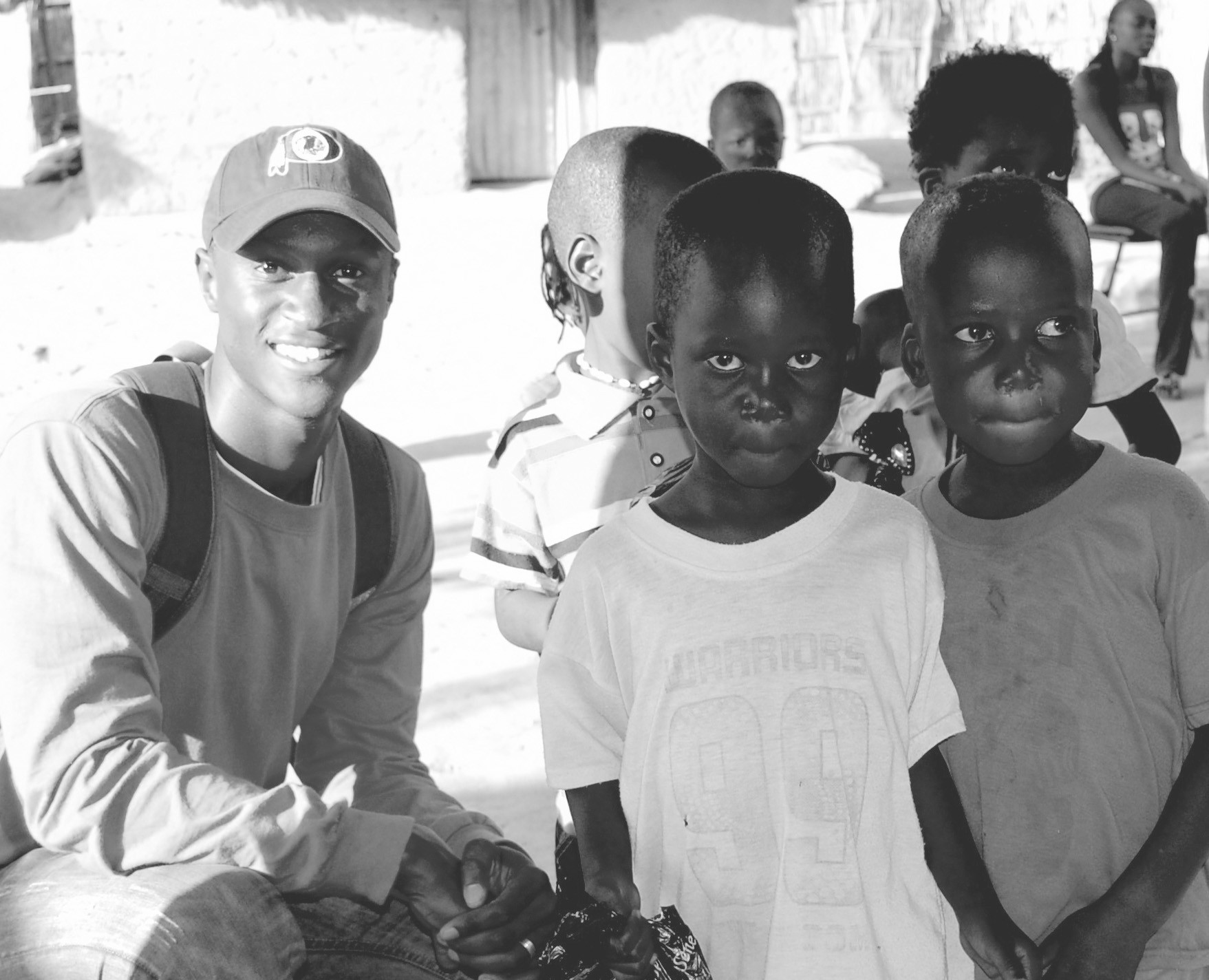 Edouard Ndecky, pictured with children from a small village in Senegal, Africa, has been spending time in Alabama with his wife, Anna Goode, an Oneonta native.