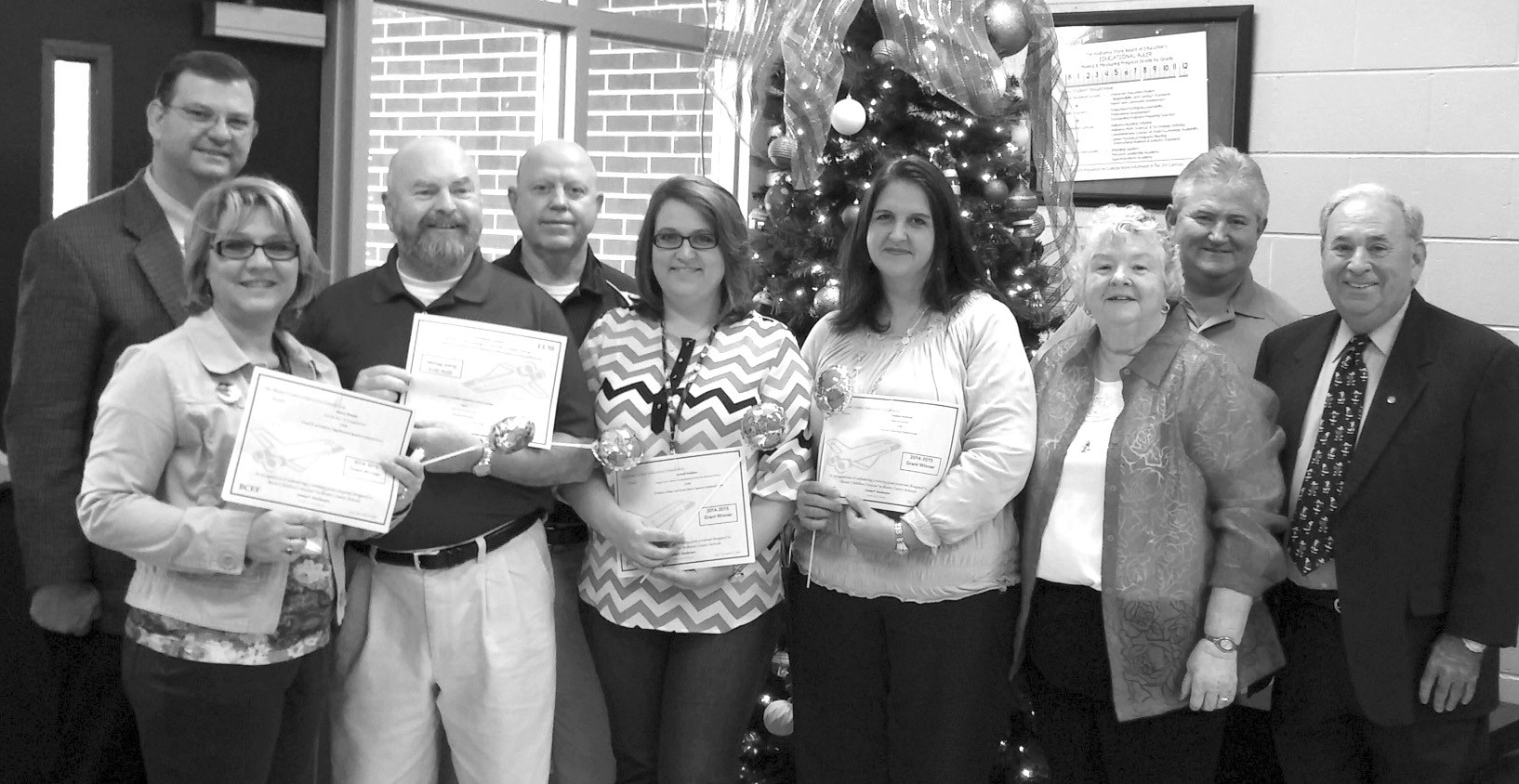 Members of the Blount County Education Foundation Board of Directors along with others from the Classroom Grant Prize Patrol present grants to teachers at Locust Fork High School.