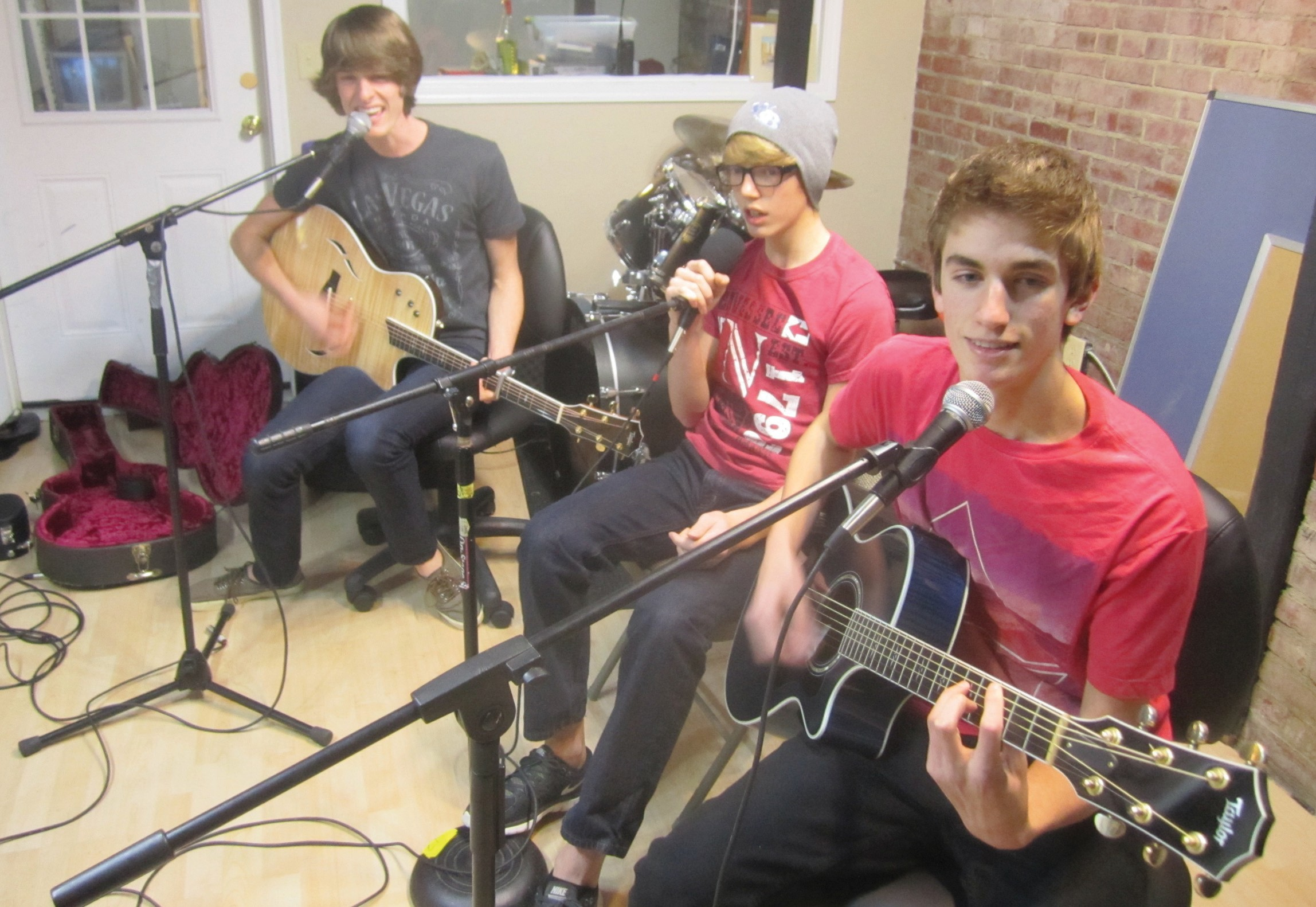 The Beason boys, from the left, Elisha 18, Christopher, 14, and Zachary, 15, rehearse in the family sound studio at Neely Arts Center in Oneonta just before a gig last week at Charlie B's. The bigger news though is that they will be on the 'Talk of Alabama' on Channel 33/40, Dec. 31, at 9 a.m. The program's entry theme music that day will be an original song 'What Do You See?' by the Beasons. It will also be the exit music, and the feature performance music they will play just before being interviewed live, as well. It's currently being mastered in Nashville and will be available on iTunes, Amazon, and other digital music sources within the week. The boys wrote the song themselves, though a detailed description of who created which parts of the music and who contributed what words would take longer than you've got, and is beyond the writer's capabilities anyway. Suffice it to say it was generally a group effort. On down the road? Keep recording new songs, build a fan base, and see where it all leads, says mother Deborah. You can join the crowd on Twitter, Facebook, or YouTube under 'The Beason Boys.' – Ron Gholson