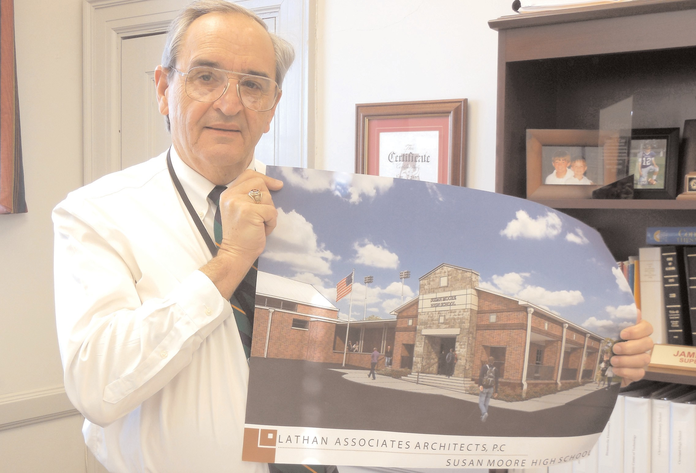Blount County Superintendent Jim Carr holds the sketch for the Susan Moore High School entrance.