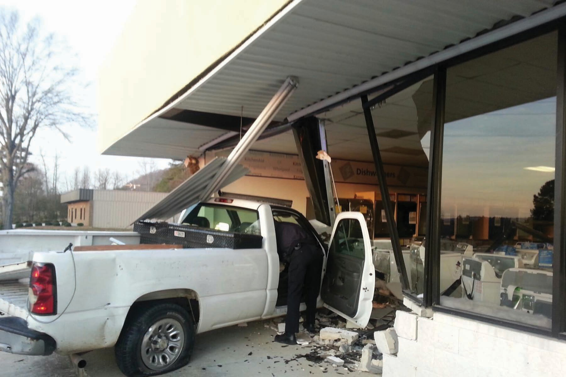 The driver of this truck lost control of his vehicle about 6:30 Sunday morning as it was headed south on Ala 75 in front of Hometown Bank. The truck left the road, jumped a ditch, and went across the parking lot before slamming into the front of Sears. The driver was taken to the hospital and treated for minor injuries, according to authorities. The building suffered extensive damage and approximately $20,000 in merchandise was lost, Sears owner Jeff Turner said. -Rob Rice