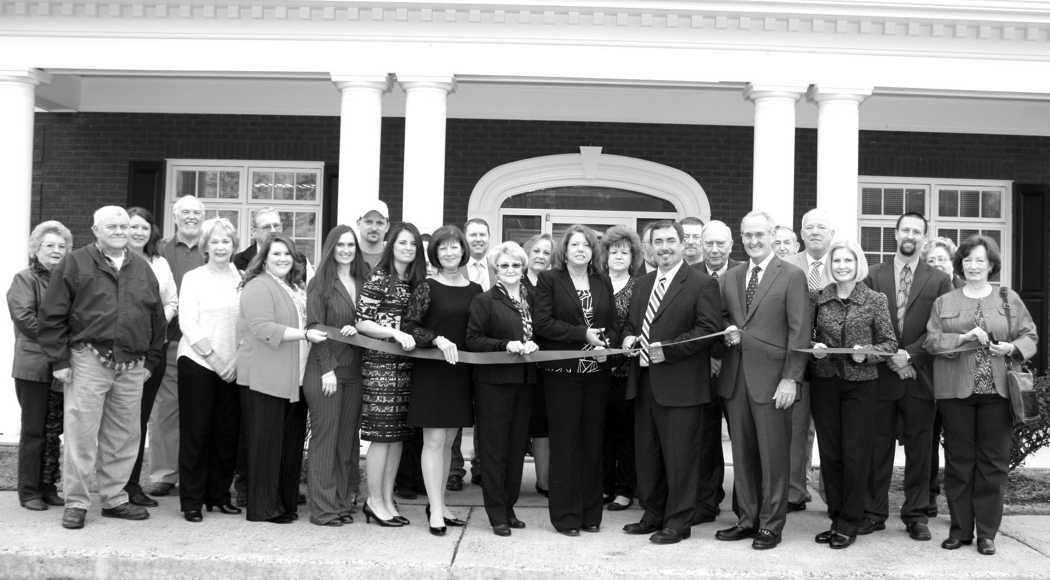 Last week, the Liberty Bank branch in Snead celebrated its grand opening with a ribbon cutting.'We pride ourselves on the level of service we provide,' says Liberty Bank president Chris Bailey.'We are always taking advantage of the latest in banking technology, but we also realize there is no substitution for one-on-one interaction. When you call us during business hours, you will hear a friendly voice on the other end of the line, not an automated answering system.' According to Bailey, a Snead native, the cornerstone of the company is remaining local. 'We are local employees with decision making authority serving local customers,' he says. Snead branch manager Joyce Breasseale agrees,'I worked at Cadence Bank in this same location when the company announced they would be closing our branch, but when Chris made the decision to bring Liberty to Snead, he hired me back, along with three other Cadence employees.' Bailey says this was important, not only to provide jobs in the community, but also so residents could continue to see familiar faces. Liberty Bank – open Monday through Thursday 8 a.m. until 4 p.m.; 8 a.m. until 5 p.m. on Friday; and 8 a.m. until noon on Saturday – is located on U.S. 278 across from Snead Park. For more information, call 466-3709. – Nicole Singleton
