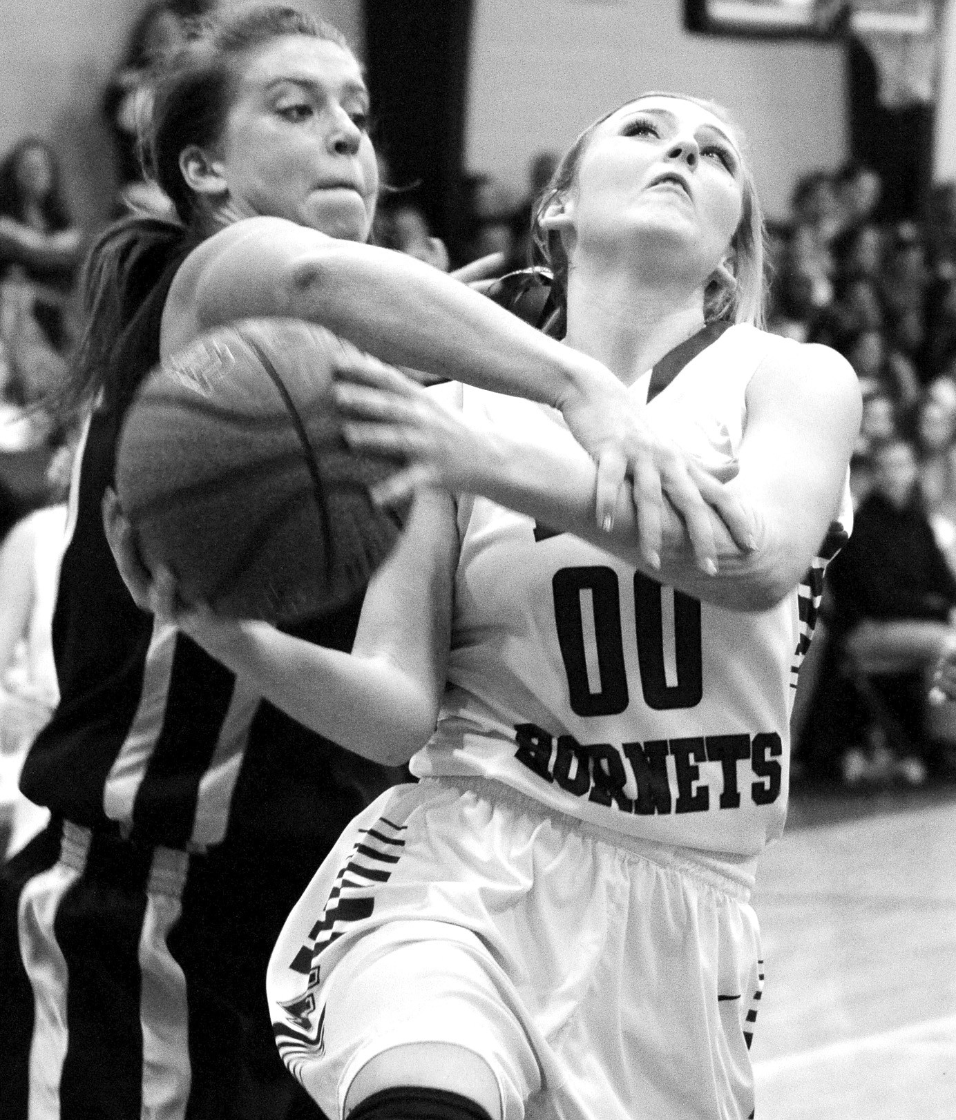 Locust Fork's Jaime Gail Hudson draws a foul on a drive to the basket.