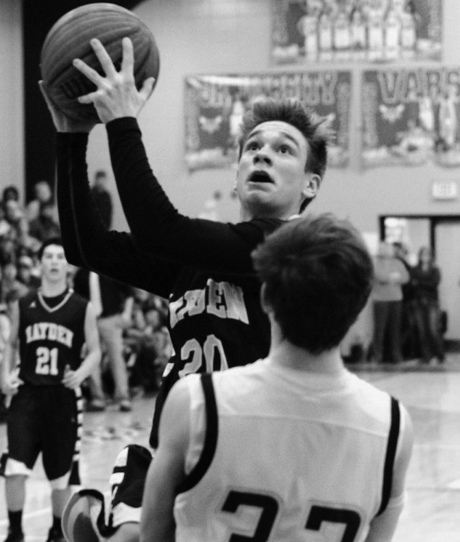 Hayden's Dylan Bradford eyes the basket as Cleveland's Caleb Corder tries to draw a charge.