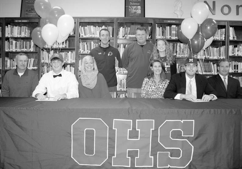 Surrounded by family, friends, and coaches, Oneonta senior baseball players Luke Wall (left) and Carter Sims signed scholarships last week. Wall, a first team all-state selection as an outfielder, signed with Faulkner State Community College in Bay Minette. He led the Redskins with a .484 batting average last year. He had a team-high 76 hits, including 18 doubles, four triples, and 40 RBIs while scoring 32 runs. Sims, a pitcher, signed with Meridian Community College in Mississippi. He was 8-3 last year with a 1.83 ERA. He held opposing batters to a .177 average and struck out 87 and walked 29 in 65 innings. He also played first base and batted .294 with a team-high three home runs with 33 RBIs. The Redskins were 34-10 last year, losing to eventual state runner-up Ardmore in the quarterfinals. -Rob Rice