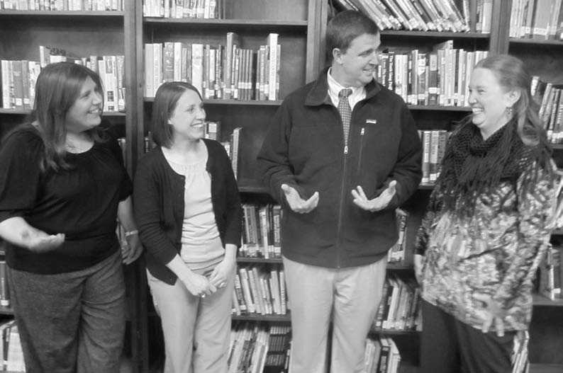 Oneonta Teachers of the Year enjoy a light moment with superintendent Michael Douglas. From the left, Jennifer Woods, Jill Phillips, Douglas, and Rhonda Ford. They have taught for two years, 14 years, and 13 years, respectively.