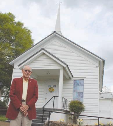 Trustee John Bobby Green stands in front of Oak Grove Methodist Church.