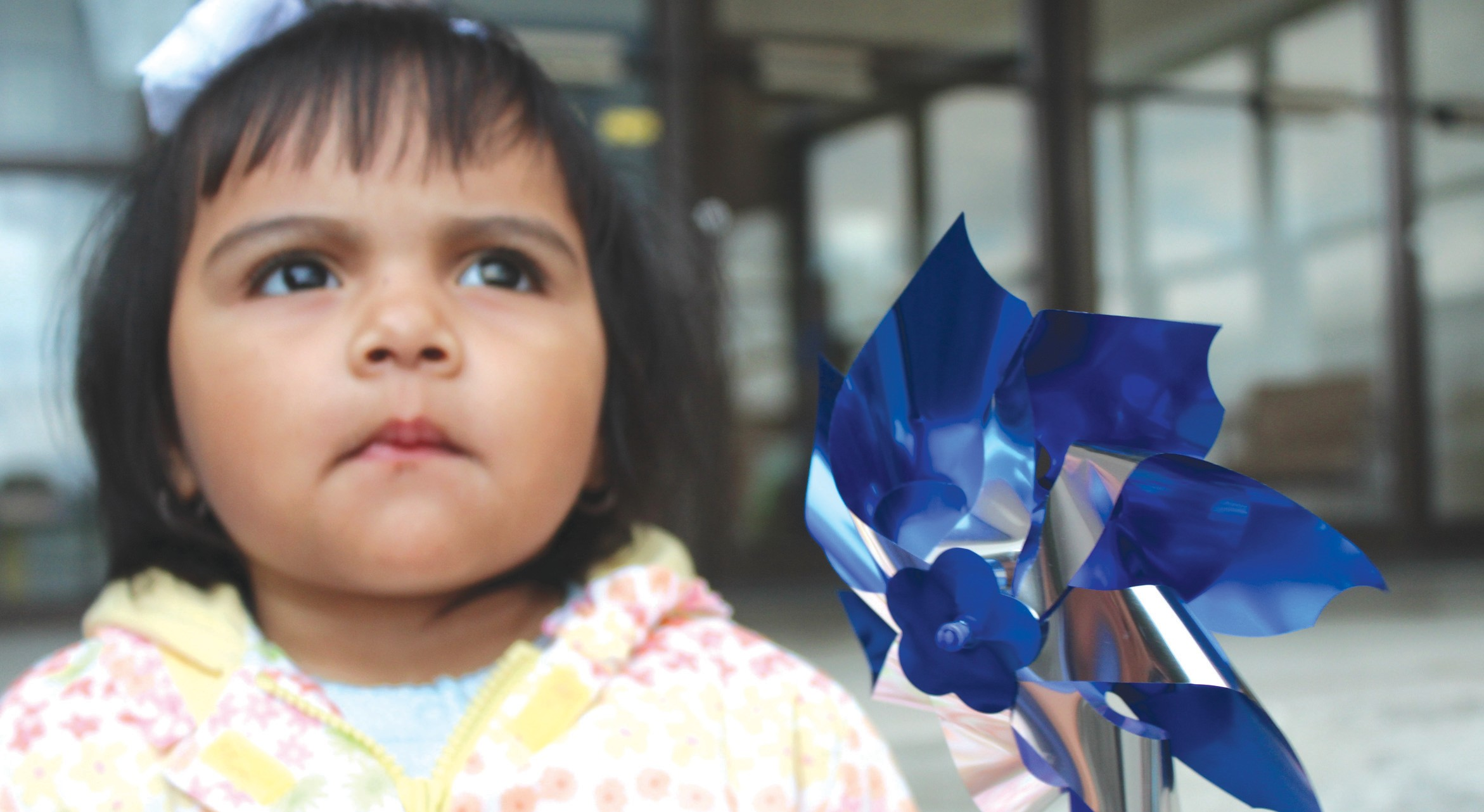 Evaly Gonzalez, age 1, holds a blue pinwheel on the steps of the Blount County Courthouse last week after she accompanied her mom, Aleyda Villegas, to the first-ever Child Abuse Awareness Walk hosted by Blount County DHR. Supporters convened at the Frank Green Building before traveling to the courthouse where Oneonta Mayor Ross Norris presented a proclamation naming April as Child Abuse Prevention and Awareness Month in the City of Oneonta. The DHR staff say this walk will continue and grow bigger next year in order to bring hope to abused children and recognize those who help them. – Nicole Singleton
