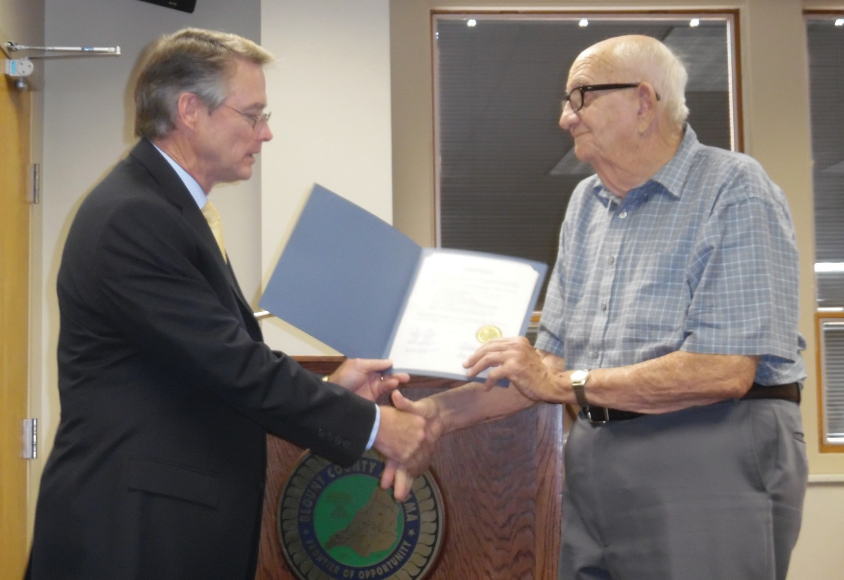 Commission Chairman Chris Green honors Eldridge Bynum with a commission resolution thanking him for his years of service and many enhancements to Palisades Park while he served on the Palisades Park Board.