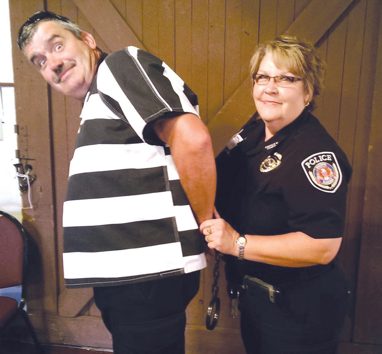 Oneonta deputy police Chief Judy Underwood 'cuffs' Oneonta Lt. Steve Gunn, 'resisting arrest' as one of more than 50 executives 'apprehended' in the Muscular Dystrophy Association's (MDA) Blount County fundraising lockup last week. The slammer was the Depot in Oneonta where jailbirds desperately worked the phones for an hour apiece to raise their ransom ('bail') of $1,600. MDA worker Katherine Shivers said the organization has already collected more than $28,000 from Blount County, exceeding the goal of $20,000 with more than a month left to go before the deadline for bail. 'We have found these areas like Blount County outside the major metros to be very successful venues for MDA,' Shivers said. 'There's more of a sense of fun and community here. We saw it at the lockup last week.' Funds collected will be used by MDA for muscle biopsies and flu shots, therapy visits at MDA-funded clinics, maintenance of wheelchairs, and summer camp for children ages 6 to 17. If you have been contacted by someone 'locked up' for the MDA, you can still respond and donate toward their bail. Underwood, incidentally was a double-duty doozy, serving as both law officer and jailbird in the faux roundup of 'offenders.' – Ron Gholson