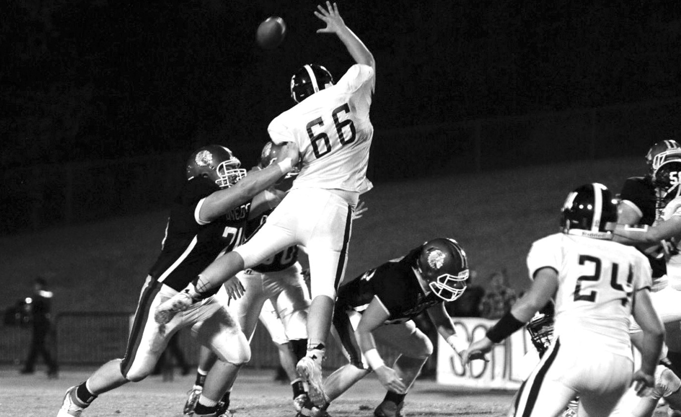 Pennington defensive end J.P. Ogle tries to knock down an Oneonta pass attempt.