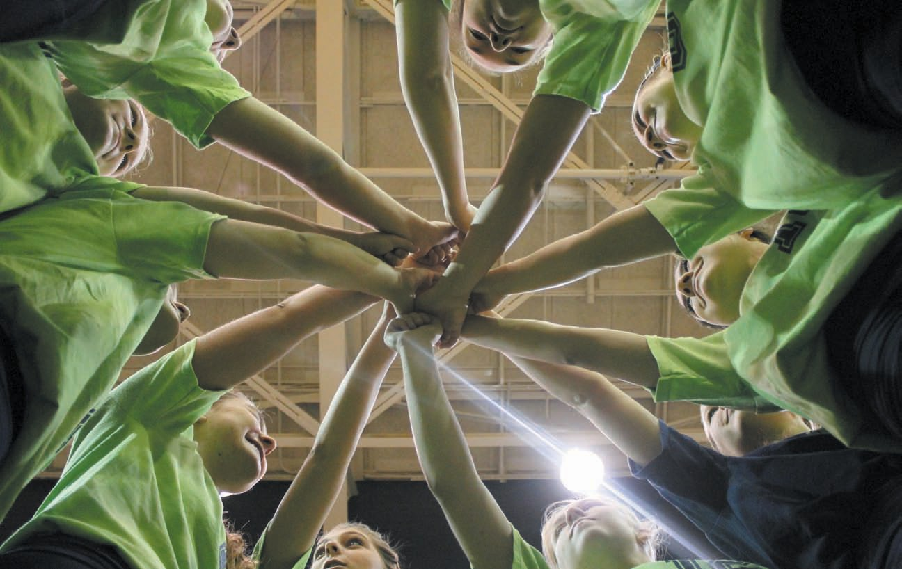 The Oneonta volleyball team huddles before competing in the Go Green Tournament last week.