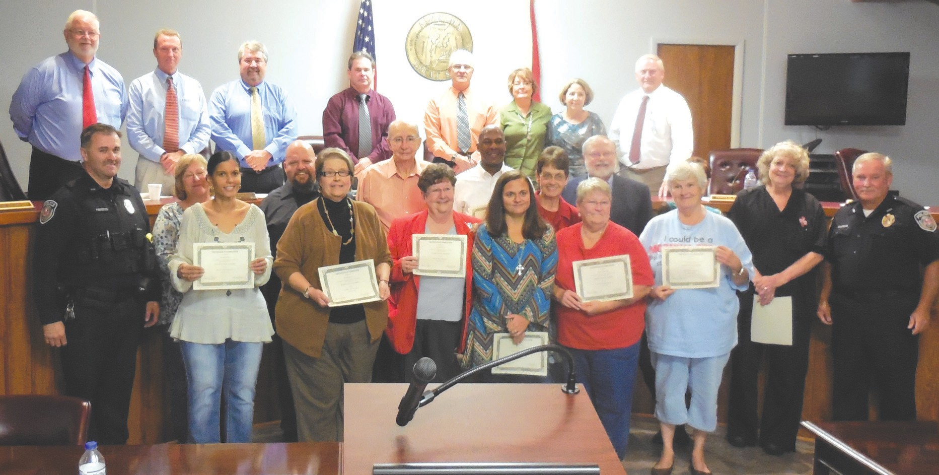 Oneonta Citizens Police Academy 2015 graduates display their certificates awarded at last week's city council meeting. Shown are [left to right (front)]: academy director officer Mike Harris, Carmen Polk, June Peppers, Carolyn Jones, Gina Jackson, Phyllis Downing, Sherry Fox, Jan Aitken, police chief James Chapman, (middle) Patty Robinson, Jeremy Lesley, Bobby Jones, Nate Butler, Maryjane Garrett, Mike Brinkman, (back) councilors Tim McNair, Hal Blackwood, Mark Gargus, city manager Ed Lowe, mayor Ross Norris, city clerk Tammie Noland, and councilors Tonya Rogers, and Danny Robinson. Graduates Bobbi Davis and Randy Casson were not in the photograph.