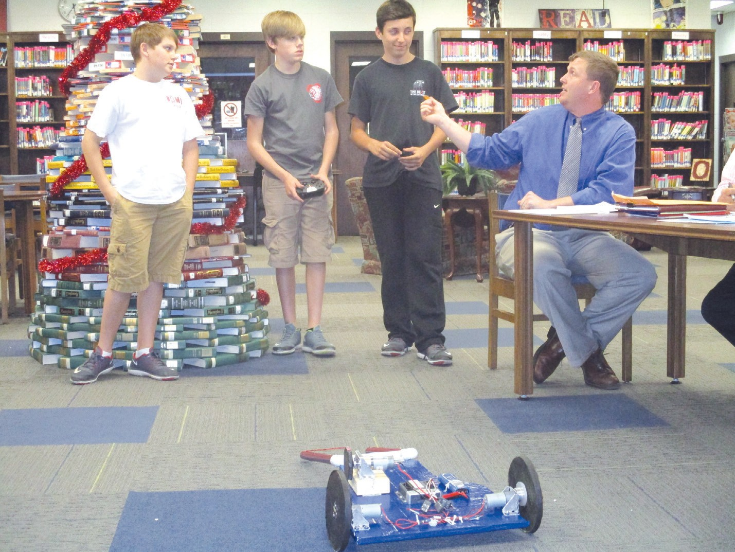 The Oneonta Robotics Team, made up (from left) of Cole Farmer, Caden Evans, and Mason Stephens showed and told the school board about their award-winning device built as a part of the Regional Best Robotics Competition. Under mentor Brad Mitchell's direction, the team won the Best Newcomer award at the event.