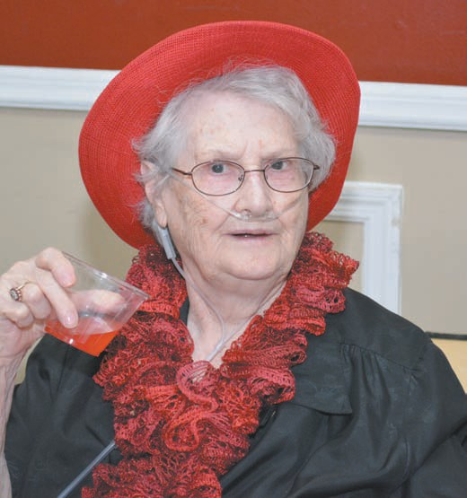 TLC resident Wilma Green enjoys the festivities at the first-ever TLC Christmas open house.