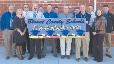 Teachers, counselors, and administrators of Blount County Schools assemble to celebrate 91 percent system graduation benchmark.