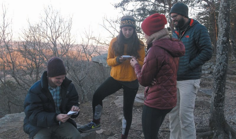 Director Mary Jeanes (in red) discusses how she wants Michael Findlay (seated) and Antonina Vargus (in yellow) to prepare for the next scene while Producer Ivo Huahua (far right) listens in.