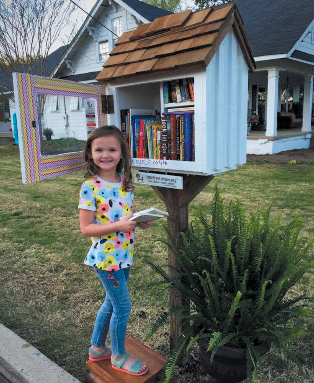 Jenna Shea, a kindergartner from OES, was the first vistitor to the Little Free Library.