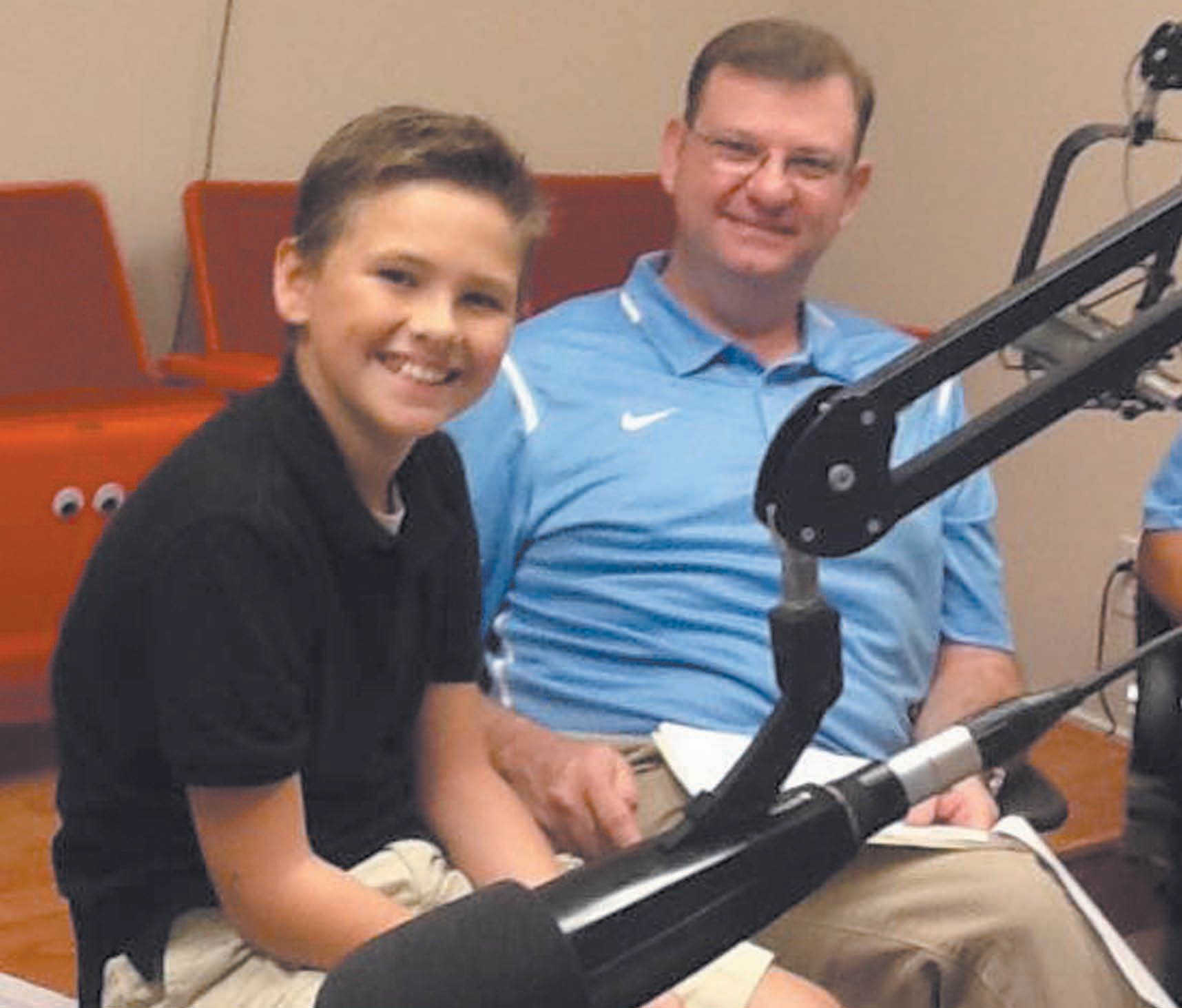 Blount County Revenue Commissioner Gregg Armstrong and son Charlie enjoy a break during the 2015 Radiothon.