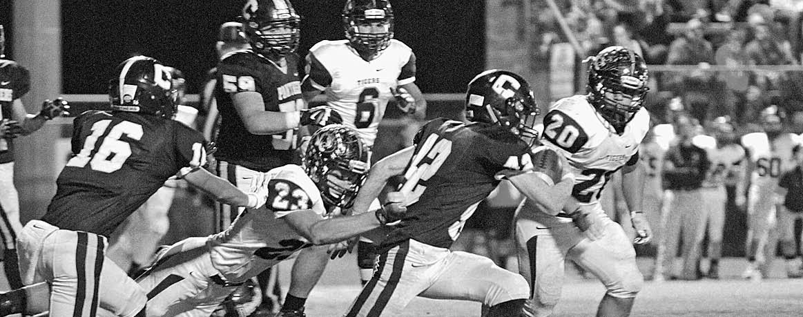 Nick Randolph (42) breaks away from the Red Bay defense with blocking help from Juan Castro (16) and Ben Aaron (59).