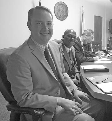 Oneonta's two newest council members (left to right), Richard Phillips and Nathaniel Butler, join veterans Hal Blackwood and Ed Lowe prior to last week's meeting.