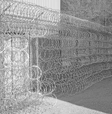 Rolls of concertina wire completely cover the security fence surrounding the Blount County Correctional Facility. The top tier is an inward-slanting 4-foot diameter run surrounding the enclosure.