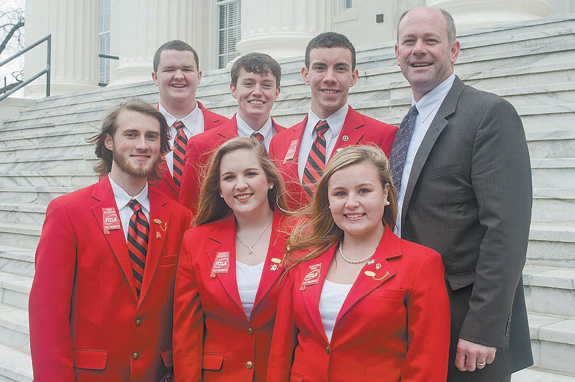 Philip Cleveland poses with members of Family, Career, and Community Leaders (FCCLA), a strategic organization to carry his message related to the group's emphasis on career preparation opportunities and preparing teens for tomorrow's work force.