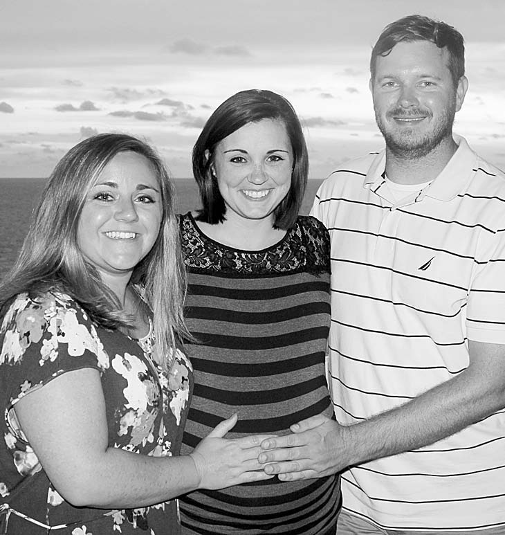 Mallory, Brooke, and Brian during the eighth month of pregnancy.