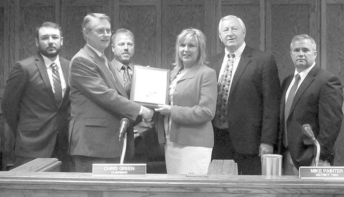 Retiring: Teresa Painter Deweese receives framed resolution for 19 years outstanding service with the county, the last eight in the commission office. Quotable: Mike Painter (her brother) – 'I told her when I took office that one of her new job requirements was to call her brother 'boss'. 'That's why I'm retiring,' Teresa called out resoundingly from the next-to-back row.