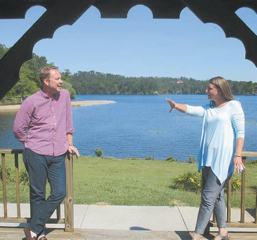 Moonlighting as dining designers, Chamber planners Richard Phillips and Aimee Wilson discuss layout of the serpentine line of tables across the park green so as to take maximum advantage of the scenic Highland Lake dining site.