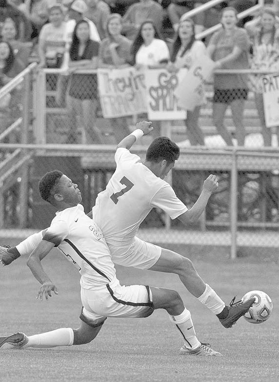 Susan Moore's Angel Duarte is brought down by an Indian Springs defender.