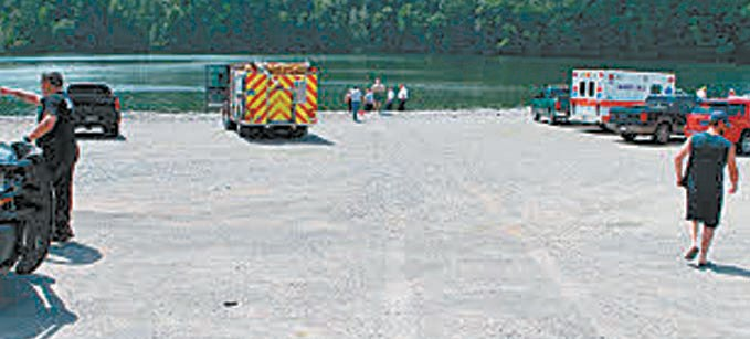 Tracks are visible in foreground where van travelled in high-speed dash to plunge into Inland Lake. The driver did not survive.