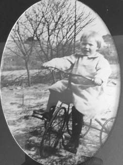 Velma Prickett rides her tricycle when she was about 2 or 3 years old. Daughter Bonnie says she almost rode the wheels off of it.